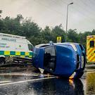 Emergency services at the scene of an overturned car on the M1 at Kennedy Way on June 16th 2019 (Photo by Kevin Scott for Belfast Telegraph)