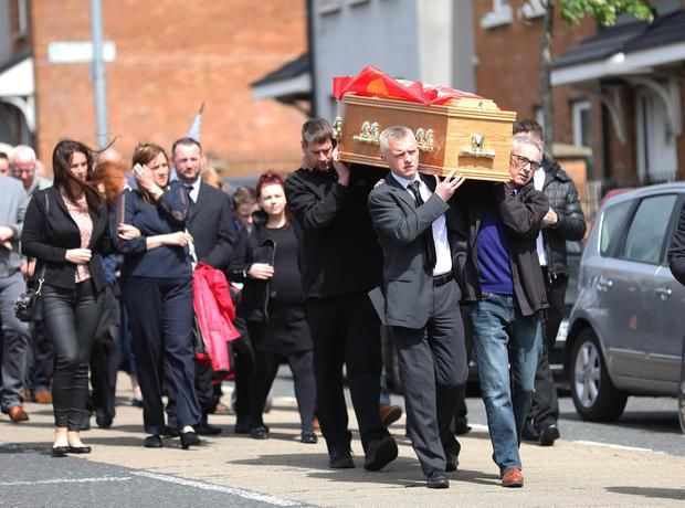 Family and Friend carry the coffin of Colin McGarry along the Oldpark road in North Belfast for a funeral at Sacred Heart Church. Pic by Peter Morrison