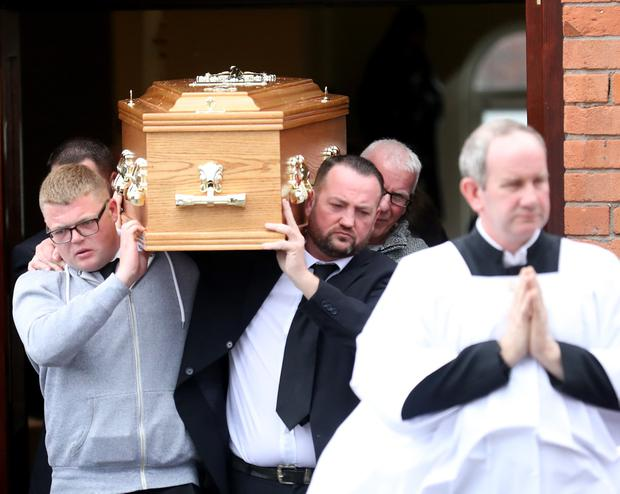 Family and friends carry the coffin of Colin McGarry from Sacred Heart Church in the old park area of North Belfast. Pic by Peter Morrison