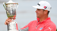 Loving look: Gary Woodland gazes at the US Open trophy after his victory at Pebble Beach