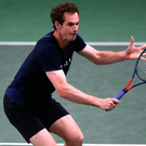 Welcome sight: Andy Murray practices at Queen's Club ahead of his doubles clash