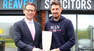 Craig Cathcart is presented with the Northern Ireland Football Writer's International Personality of the Year prize.