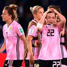 Sore point: Erin Cuthbert and her Scotland team-mates feel the heartbreak after their agonising exit from the World Cup last night