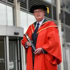 Sir George Hamilton with his honorary degree.
