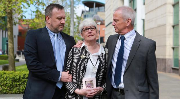 Alan and Jennifer Roberts joined by their son Gareth outside Laganside Courts on the final day of the inquest into the death of Claire Roberts