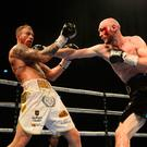 Iron-willed: Steven Ward lands on Liam Conroy as he showed great heart to secure the WBO European title on points