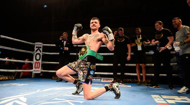 Champion: Tyrone McKenna celebrates title success at Ulster Hall last night