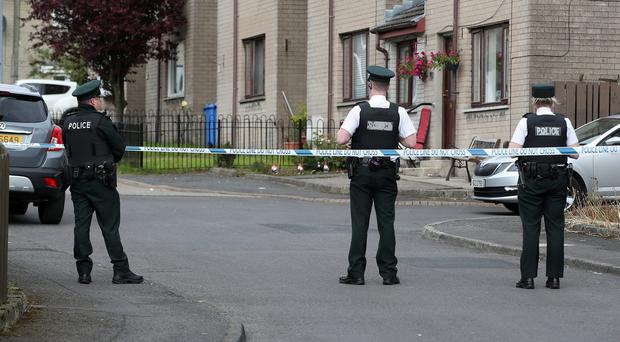 Police at the scene at Coulson Avenue. Credit: Press Eye