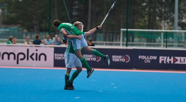 Ulstermen Neal Glassey and Sean Murray celebrate the fourth and winning goal as Ireland reached today's final