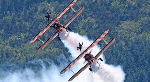 The AeroSuperBatics wingwalkers during the Festival of Flight in Newcastle, Co Down. PRESS ASSOCIATION Photo. Picture date: Saturday June 22, 2019. Photo credit should read: Niall Carson/PA Wire