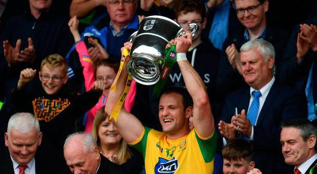 Michael Murphy of Donegal lifts the Anglo-Celt Cup.