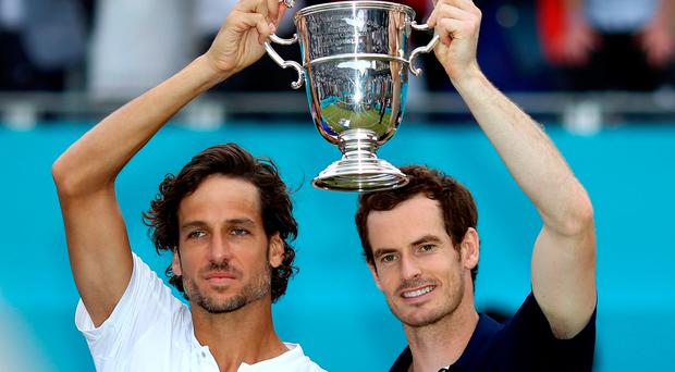 Andy Murray (right) and Feliciano Lopez (left) celebrate victory in the Men's Doubles final with the trophy during day seven of the Fever-Tree Championship at the Queen's Club, London. PRESS ASSOCIATION Photo. Picture date: Sunday June 23, 2019. See PA story TENNIS Queens. Photo credit should read: Steven Paston/PA Wire. RESTRICTIONS: Editorial use only, no commercial use without prior permission.
