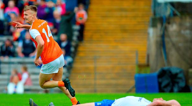 Orange crush: Armagh's Rian O'Neill celebrates one of his goals