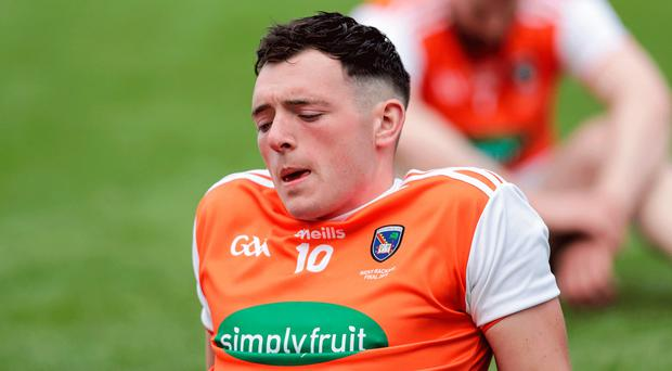 Cruel defeat: Armagh's Shaun Toal at the final whistle