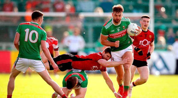 Big leap: Down's Conor Poland with Aidan O'Shea and Lee Keegan of Mayo at Pairc Esler