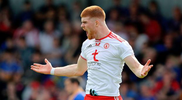 Goal trail: Cathal McShane celebrates his double for Tyrone