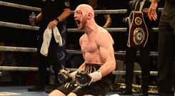 Steven Ward celebrates his bloody victory over Liam Conroy at the Ulster Hall.