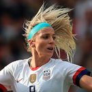 Tight battle: Spain ace Jennifer Hermoso battles for possession with Julie Ertz of the USA in Reims