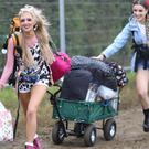People arrive on the first day of the Glastonbury Festival (Yui Mok/PA)