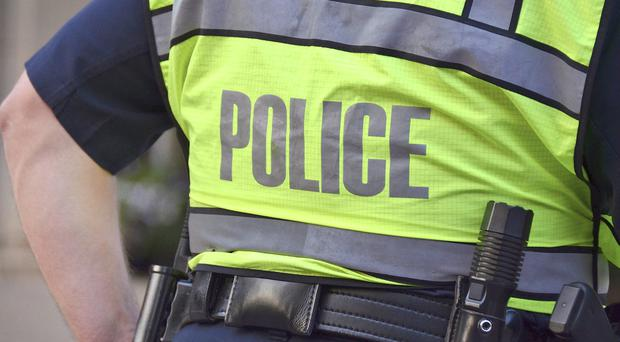 A man believed to have assaulted and robbed another man ran into the side of a moving vehicle before he was arrested in north Belfast, police have said