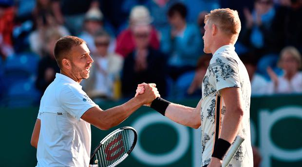 Well done: Dan Evans congratulates GB compatriot Kyle Edmund after their match at the Nature Valley International