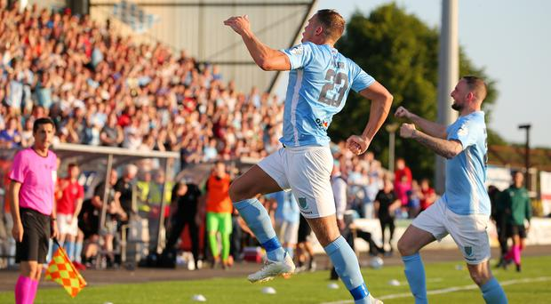 Ballymena's Leroy Millar (left) celebrates after opening the scoring at the Showgrounds.