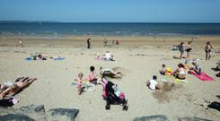 People enjoy the beach at Helen's Bay, County Down, Friday, June 28th, 2019. (Photo by Paul McErlane for the Belfast Telegraph)