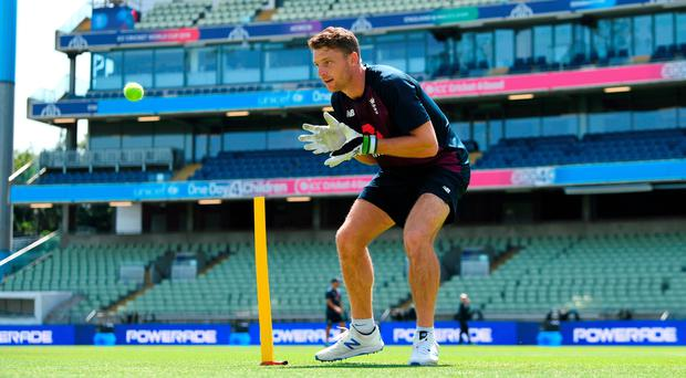 Safe hands: Jos Buttler of England takes part in a wicketkeeping drill during a nets session at Edgbaston