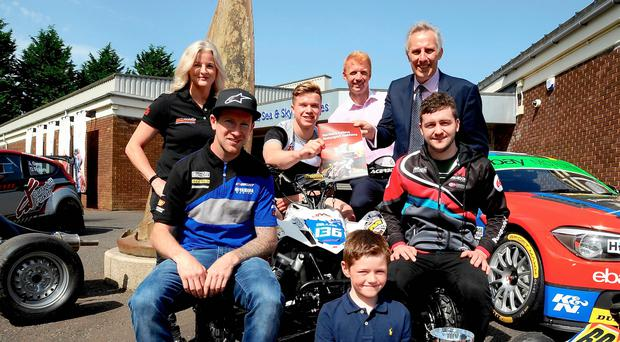 Driving ambition: Maria Costello, Dean Dillon, Gordon Crockard, Ian Paisley MP (front row) Martin Barr, Rory Armstrong and Adam McLean pictured at the launch of the Northern Ireland Motorsport Taskforce report