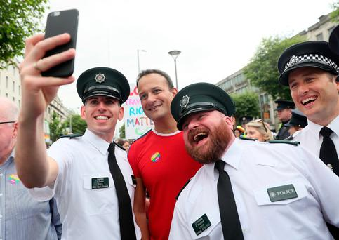 An Taoiseach Leo Varadkar poses for a photo with PSNI officers ahead of the start of the Pride parade in Dublin. Credit: Brian Lawless/PA Wire