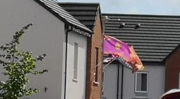 The UVF flags in Cantrell Close