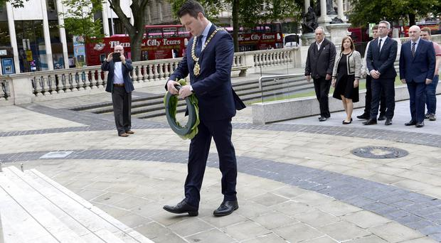 Belfast Mayor John Finucane pictured as he lays a laurel wreath at the City Hall in remembrance of those killed at the Somme. Credit:Stephen Hamilton-Presseye