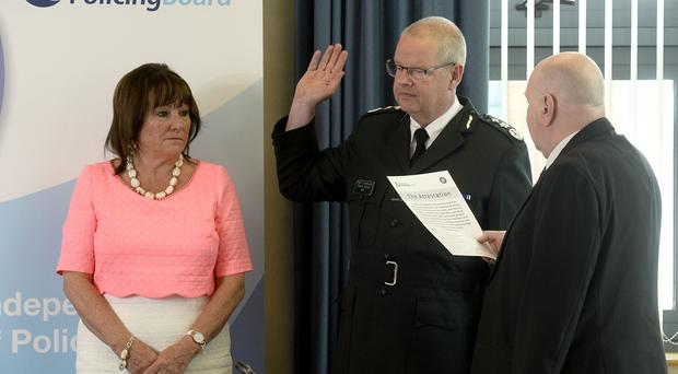 Swearing in as the new PSNI Chief Constable at Policing Board HQ today is Simon Byrne with Policing Board Chair Anne Connolly with JP Prof David Flynn. Photograph: Stephen Hamilton /Presseye