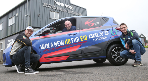 Up for grabs: fonaCAB Ulster Grand Prix clerk of the course, Noel Johnston, with Peter Hickman and Dean Harrison with the Hyundai i10 car supplied by Daly's Hyundai, Belfast that is to be raffled with the winner announced on race day, August 10