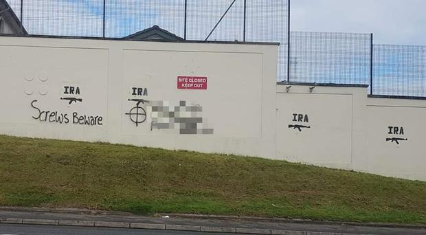 The graffiti that has appeared outside the former police station in Stewartstown