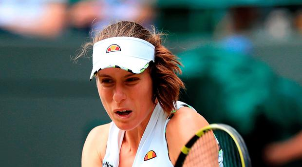 Easing through: Johanna Konta reached the second round at Wimbledon by beating Ana Bogdan yesterday