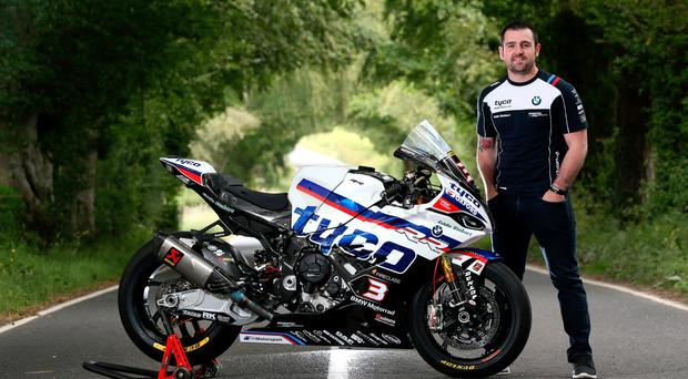 Back again: Michael Dunlop with his Tyco BMW S1000RR Superbike photographed along the Cochranstown Straight on the Ulster Grand Prix circuit at Dundrod