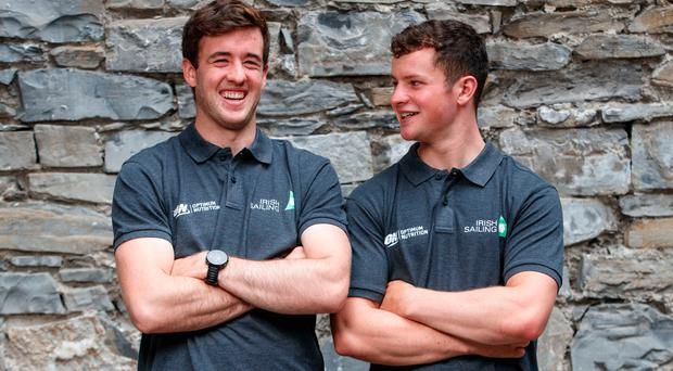 Smooth sailing: Team-mates Finn Lynch (left) and Liam Glynn share a laugh ahead of the Laser World Championships in Japan