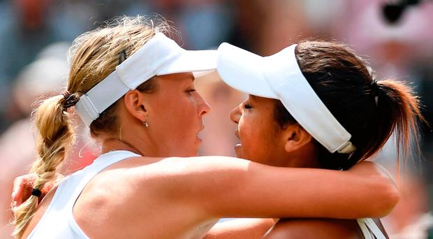 Well done: Anett Kontaveit (left) is congratulated by Britain's Heather Watson after their second round clash at SW19