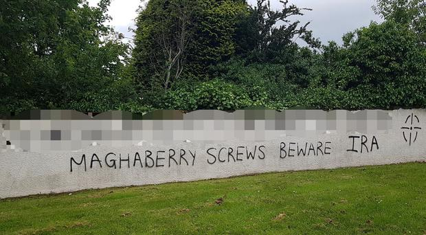 Graffiti threatening prison staff appeared on a wall in Londonderry. Credit: BBC NI