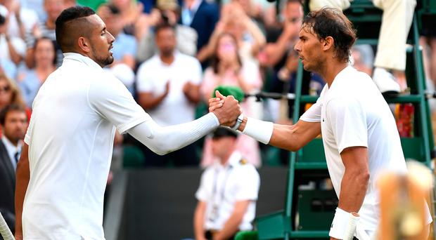 Nick Kyrgios and Rafa Nadel shake hands after their match on Thursday.
