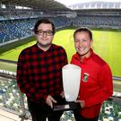 Glentoran's Demi Vance picks up the Belleek Player of the Month award from NIFWA chair Keith Bailie.