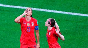Feeling heat: Alex Morgan (left) performs her tea sipping celebration against England