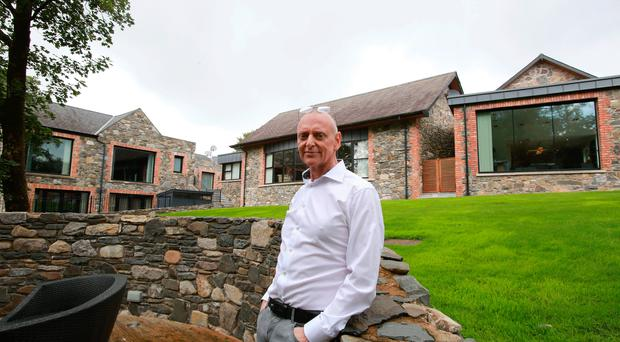 Kevin McWhinney outside his Lisburn home