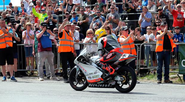 Victory salute: Gary Dunlop hailed by the crowd after winning the 125cc/Moto3 race at the Skerries 100