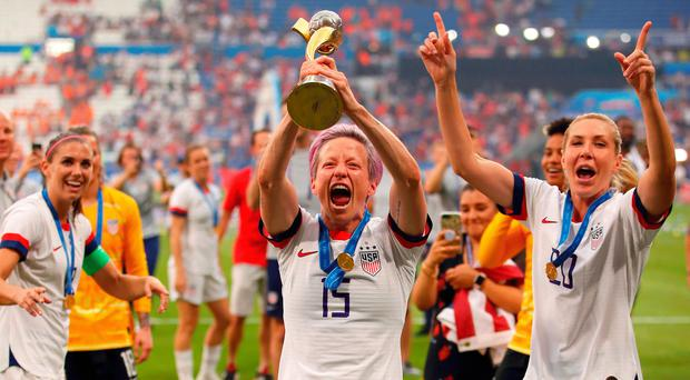 Star spangled: Megan Rapinoe celebrates with the World Cup Trophy after last night's win over Holland in Lyon