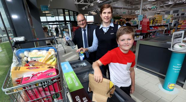 From left: Ricky Burnett of arc21, Lidl Connswater store manager Ineta Zukauskiene, and Lewis Armstrong (10)