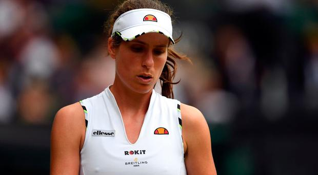 Johanna Konta reacts during her match on day eight of the Wimbledon Championship. Credit: Victoria Jones/PA Wire.