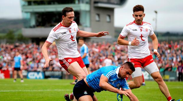 Close eye: Tyrone ace Colm Cavanagh with James McCarthy of Dublin
