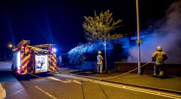 Firefighters extinguish the remainder of the Ashdale Street bonfire in east Belfast at 3am. (Photo by Kevin Scott for Belfast Telegraph)